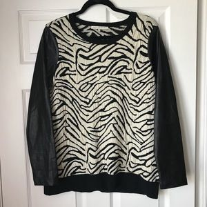 Zebra print sweater with patent leather sleeves